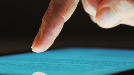 Person using tablet computer close up