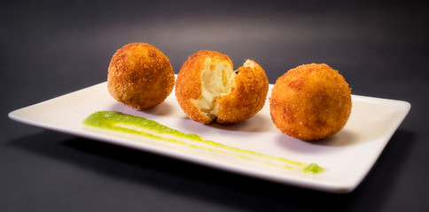 Creamy and smooth fried croquettes. Typical Spanish tapa.