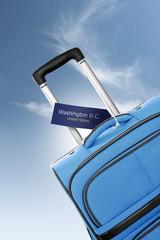 Washington, United States. Blue suitcase with label