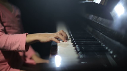 The child learns to play the piano. Video with sound.