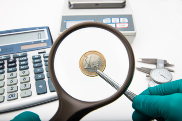 One Euro coin inspection