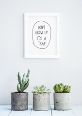 "MOTIVATIONAL POSTER WITH SUCCULENTS  ""don't grow up it's a trap"""