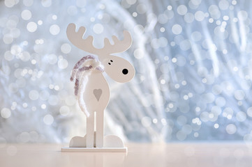 White Christmas moose with a heart