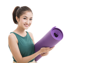 Young attractive woman holding a yoga mat. Isolated on white