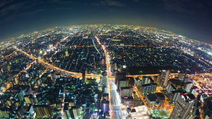 Timelapse video of Osaka in Japan at night, fisheye aerial view