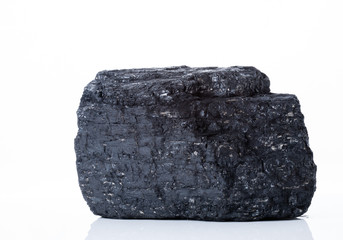 large piece of black bituminous coal on a white background