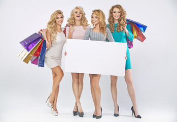 Group of pretty ladies advertising the sale