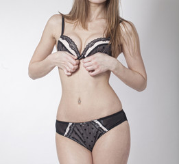 attractive woman dressed bra and panties in studio