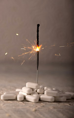White Pills  with Sparkler for Drug Abuse Concept