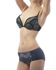 attractive woman dressed bra and panties in studio