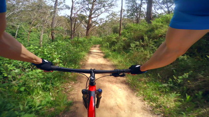 Mountain biking on a dirt road, three different views