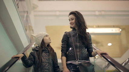Mother and daughter in a supermarket on the elevator.