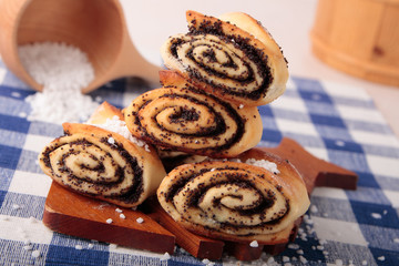 Rolls stuffed with sugar and  poppy