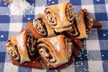 Sweet rolls stuffed with poppy and sugar