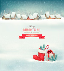 Holiday Christmas background with a village, a boot and a gift b