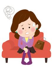ソファーで悩む女性