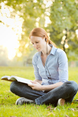Woman with a Book and Music in a Park