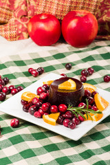 Cranberry sauce on plate with red apples