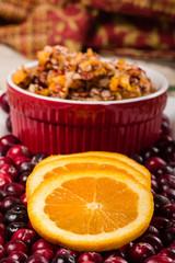 Orange slices on plate of cranberries
