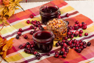 Cranberry sauce with cranberries and fall leaves