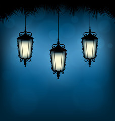 Three illuminated lanterns with pine branches on blue background