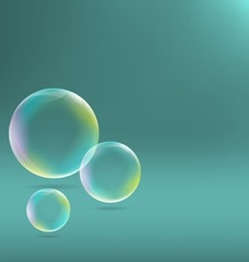 Three transparent soap bubbles with shadows on cyan background