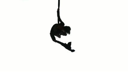 Woman dancer on aerial silk, aerial contortion, aerial ribbons,
