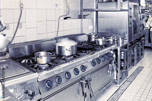 Foto op Canvas Koken Real restaurant kitchen, toned image