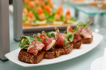 Snacks with parma ham and figs