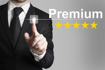 businessman pushing button premium