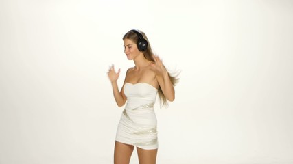 Beautiful female in headphones listening to the music with