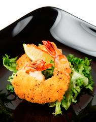 Deep fried shrimps on black plate