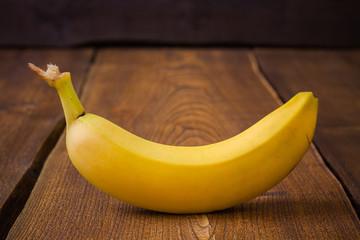Banana fruit on dark wooden table