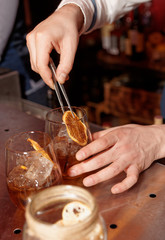 Barman works at bar counter, slightly toned