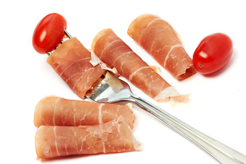 Ham on a fork and tomato