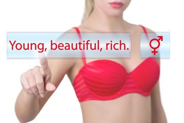 woman pressing young, beautiful, rich button