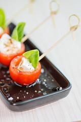 Mini caprese finger food appetizers, with tomato and mozzarella