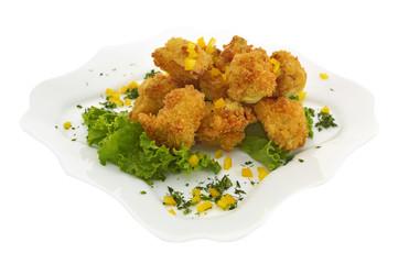 Deep fried meat in crumbs on lettuce leaves