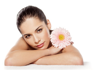 Portrait of lying beautiful young woman with gerbera