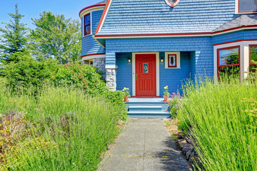 Blue entrance porch with red door.