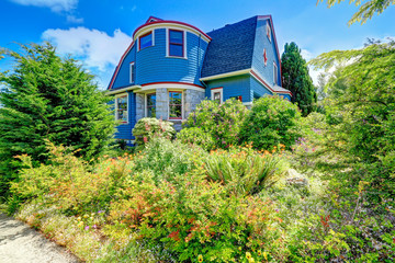 Blue house exterior with red trim