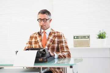Retro man typing on typewriter
