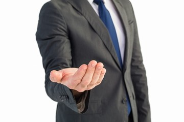 Businessman holding out his hand