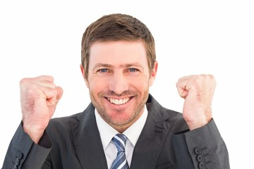 Businessman smiling and cheering
