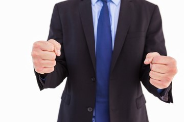 Businessman with clenched fist in front of him