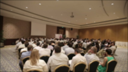 Many people at a conference or seminar. Blurred background