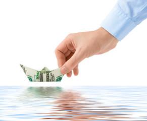 Hand launching money ship
