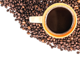 Orange cup of coffee on a background coffee beans