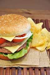 hamburger with cheese, tomato, onion and lettuce
