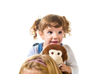 Little girl playing with stuffed animal
